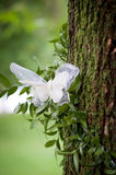 Wedding decoration with a lace butterfly in a tree Royalty Free Stock Photography