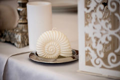 Wedding decoration in a Mediterranean style white shell with  light cloth on  metal stand Stock Photography