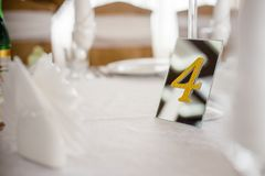 Wedding decoration, mirror number on a table of gold royalty free stock photos