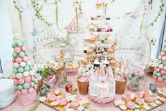 Wedding decoration with pastel colored cupcakes, meringues, muffins and macarons Stock Photos