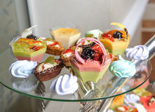 Wedding decoration with pastel colored cupcakes, meringues, muffins and macarons Royalty Free Stock Photography