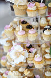 Wedding decoration with pastel colored cupcakes, meringues, muffins and macarons. Elegant and luxurious event arrangement Stock Images