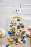 Wedding decoration with pastel colored cupcakes  Stock Images