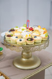 Wedding decoration with pastel colored cupcakes  Royalty Free Stock Image