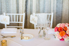 Wedding decoration with pink flowers, gold candels and rose. Romantic. Sign Mrs. and Mr. stock photo