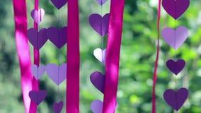 Wedding decoration, purple hearts, crimson ribbons stock video footage
