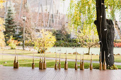 Wedding decoration of the restaurant with the golden bottles Stock Image
