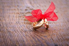 Wedding decoration rings with red ribbon. Stock Photo