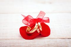 Wedding decoration rings with red ribbon. Stock Photography