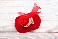 Wedding decoration rings with red ribbon Stock Image
