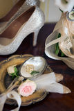 Wedding decoration: shoes, rings and bouquet on a table Stock Photo