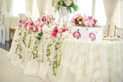 Wedding decoration on table. Floral arrangements and decoration. Arrangement of pink and white flowers in restaurant for event. Wedding decoration on table Stock Photos