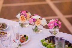 Wedding decoration on table. Floral arrangements and decoration. stock photos