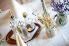 Wedding decoration table with lavender and greenery Stock Photos