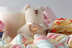 Wedding decoration with toy bear and rings Stock Photos