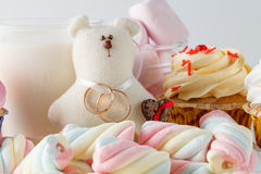 Wedding decoration with toy bear and rings Stock Images