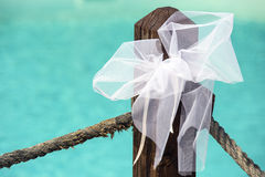 Wedding decoration. White bow with pool on background Royalty Free Stock Images