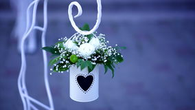 Wedding decoration - white metal bucket with white flowers on the blue background.  stock video footage