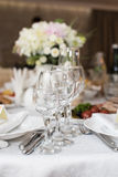 Wedding decoration. With wine glasses, flowers and cutlery Stock Images