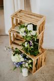 Wedding decoration. Wooden crates with flowers and candles. Wedding decoration Royalty Free Stock Photos