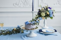 Wedding decorations with candles, cake and beautiful flowers royalty free stock image
