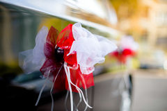 Wedding decorations for the car. Wedding decoration of red and white car Royalty Free Stock Photos