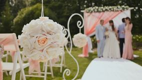 Wedding arch and white chairs in the open air stock video video of wedding decorations on chairs made of flowers in the open air a bride and groom junglespirit Image collections