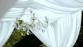 Wedding decorations. crystal chandelier on a arch stock video