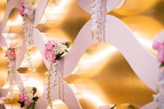Wedding decorations. Wedding decor of real flowers in golden light Royalty Free Stock Photo