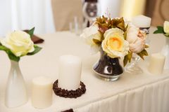 Wedding decorations . Flowers and coffee beans. Wedding decorations . Poor flowers and coffee beans Royalty Free Stock Photo