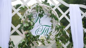 Wedding decorations with flowers, hearts, butterflies. Wedding ceremony. Two letters K and T. Wedding decorations with flowers, hearts, butterflies. Wedding stock footage
