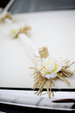 Wedding decorations flowers on a white car Royalty Free Stock Image