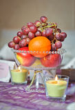 Wedding decorations with fruits and candles Stock Photos