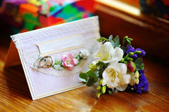 Wedding decorations and greeting card on flowers background Stock Images