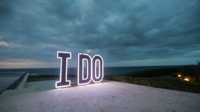 Wedding decorations. LED letters on the ground near the sea stock video