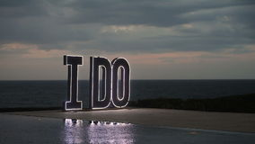 Wedding decorations. LED letters on the ground near the sea stock video footage