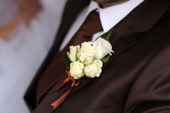 Wedding decorations little boquet on a jacket Royalty Free Stock Photos