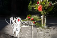 Wedding decorations red roses and white shoes Stock Photography