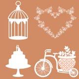 Wedding decorations. Symbols. Wedding decorations. Decorative bicycle. Decorative cage. A wedding cake. Heart made of butterflies. Symbols Stock Photo