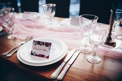 Wedding decorations. Table decorated with pink cloth royalty free stock photos