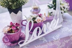 Wedding decorative elements and flowers on the table. Celebrating Valentine`s Day or wedding Royalty Free Stock Photo