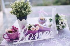 Wedding decorative elements on a table for a couple in love. Wedding decorative elements on a table for a loving couple in light colors Royalty Free Stock Photo