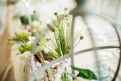 Wedding decorative floral flower bouquet arrangement on the tabl Royalty Free Stock Images