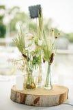 Wedding decorative floral flower bouquet arrangement on the tabl Stock Photo