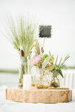 Wedding decorative floral flower bouquet arrangement on the tabl Royalty Free Stock Photo