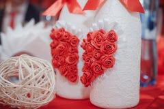 Wedding decorative white bottles with alcohol. Stylish decoration of the wedding banquet Stock Images