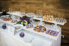 Wedding dessert. With delicious cakes and macaroons royalty free stock image