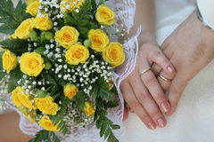 Wedding detail. Of the bouquet and hands holding Royalty Free Stock Image