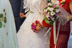 Wedding. Detail - bride and godmother bouquets royalty free stock photo