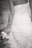 Wedding details. The bride in a dress with a wedding bouquet Royalty Free Stock Image